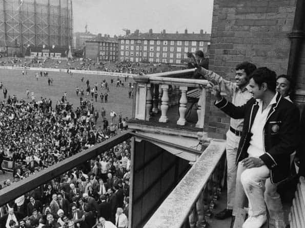 Bhagwat Chandrasekhar (left) and Indian captain Ajit Wadekar (in blazer) come out in the dressing room balcony at The Oval to acknowledge the cheering of the Indian supporters after India won the Test to register its first away-series win in England © Getty Images