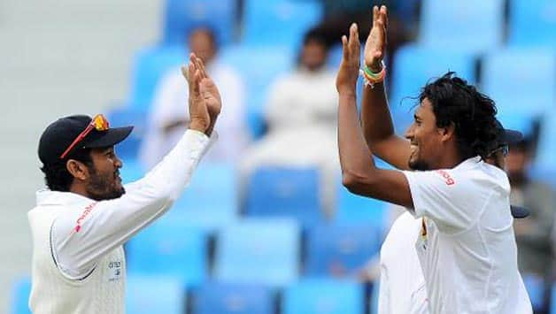 Suranga Lakmal (right) took three wickets for Sri Lanka against Bangaldesh at Mirpur © AFP