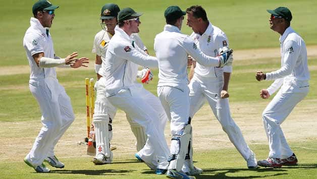 South African players celebrate the dismissal of David Warner © Getty Images