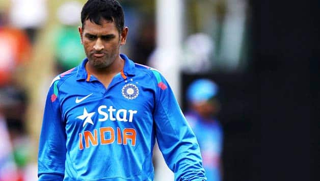 MS-Dhoni-of-India-walks-off-the-field-with-the-rain-delay-during-the-O