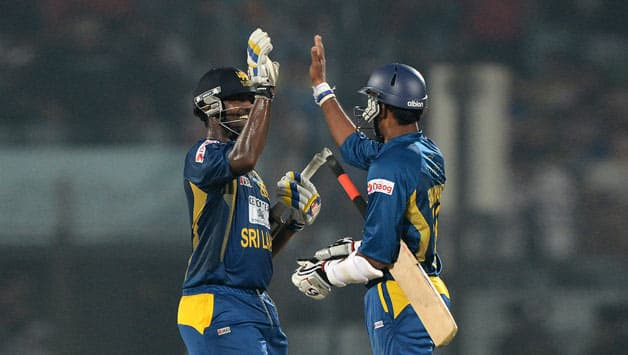 Thisara Perera (left) and Sachitra Senanayake were the starts of Sri Lanka's 1st ODI win © AFP