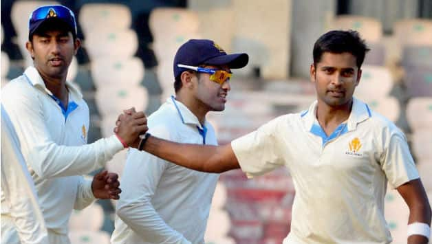 Vinay Kumar is congratulated by his Karnataka teammates