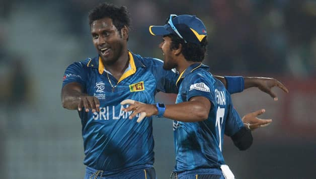 Angelo Mathews (left) was on a hat-trick in his first over © Getty Images