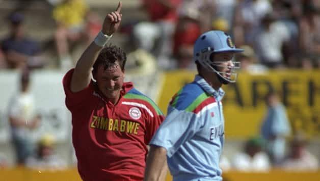 Eddo Brandes (left) celebrates the dismissal of England batsman Graeme Hick © Getty Images