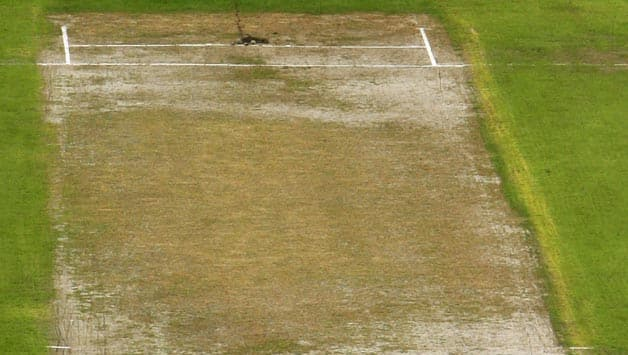 A-general-view-of-the-Lancashire-wicket,-as-play-is-delayed-due-to-the-bad-conditio