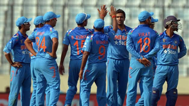 Indian-cricketers-celebrate-the-wicket-of-Afghanistan-batsman-Mohammad-Shahzad-during-the-ninth-match-of-the-Asia-Cup