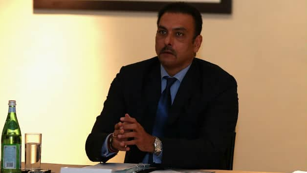 Ravi Shastri is a paid commentator with the BCCI and many have questioned the board's decision to appoint him in the probe panel for the IPL spot-fixing controversy © Getty Images