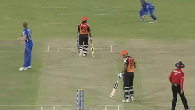 James Faulkner's (left) is collected by Sanju Samson (top right). Amit Mishra is trudging back towards the crease.