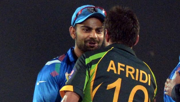 Indian-captain-Virat-Kohli-(L)-congratulates-Pakistani-batsman-Shahid-Afridi-for-their-team's-win-during-the-sixth-match-of-the-Asia-Cup-one-day-cricket-tournament-between-India-and-Pakist