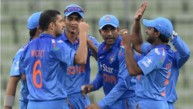 Indian cricketers celebrating a wicket © AFP