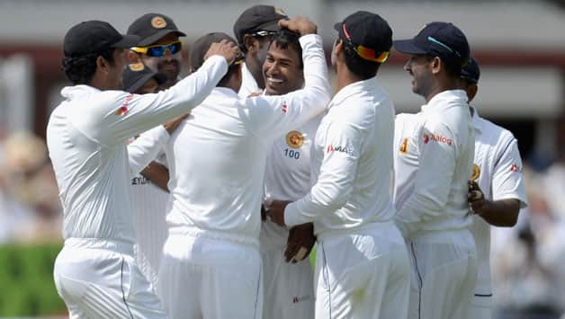 Nuwan-Kulasekara-of-Sri-Lanka-celebrates-with-teammates-after-dismissing-England-captain-Alastair-Cook-during-day-one--60