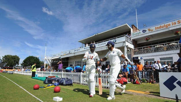 India openers Shikhar Dhawan (left) and Murali Vijay walk out to bat © Getty Images