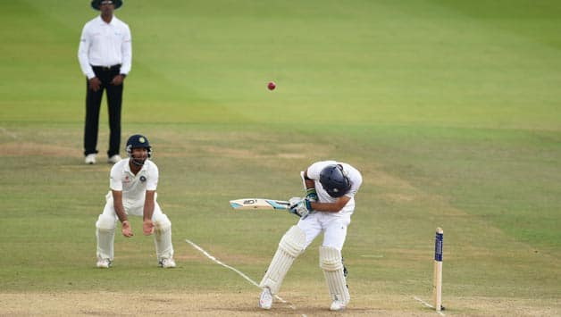 England-batsman-Moeen-Ali-spoons-the-ball-up-to-be-caught-by-India-fielder-Cheteshwar-Pujara