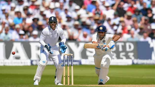 MS Dhoni (right) is batting on 81 at lunch on Day Two of the first Test against England © Getty Images