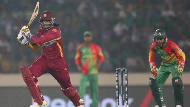 Chris-Gayle-of-the-West-Indies-bats-as-Mushfiqur-Rahim-of-Bangladesh-looks-on-d-330