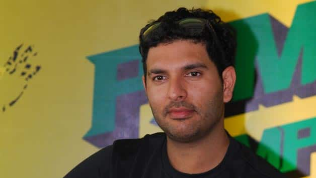 Yuvraj Singh accepted the Íce Bucket Challenge' from tennis star Sania Mirza © IANS
