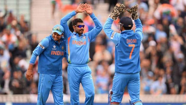 Ravrinda-Jadeja-of-India-celebrates-with-Mahendra-Singh-Dhoni-and-Suresh-Raina-(L)-after-dismissing-Johnson-Charles-of-West-Indies-during-the-ICC