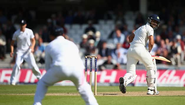 Virat-Kohli-of-India-looks-back-as-he-is-caught-out-by-Alastair-Cook--222