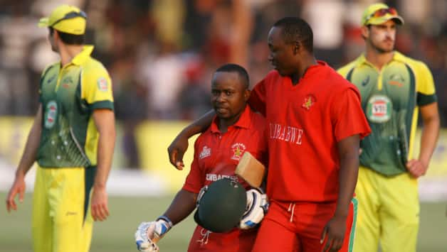 Prosper Utseya (left) and Elton Chigumbura put up an unbeaten 55-run stand for the eighth-wicket to guide Zimbabwe to an unlikely victory over Australia © AFP