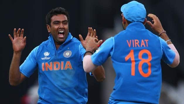 Ravichandran-Ashwin-(L)-of-India-celebrates-with-Virat-Kohli-(R)-after-taking-the-wicket-of-Joe-during-the-ICC-Champions-Trophy-Final-match