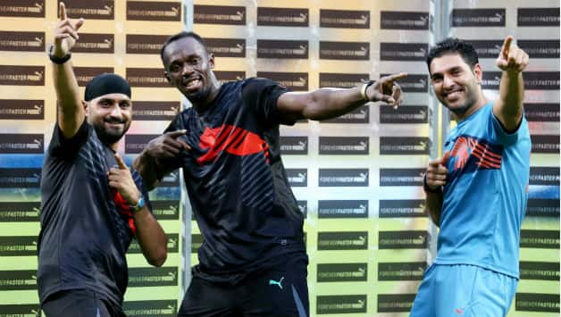 (Clockwise from left) Harbhajan Singh, Usain Bolt and Yuvraj played an exhibition cricket match at the Chinnaswamy on Tuesday © PTI