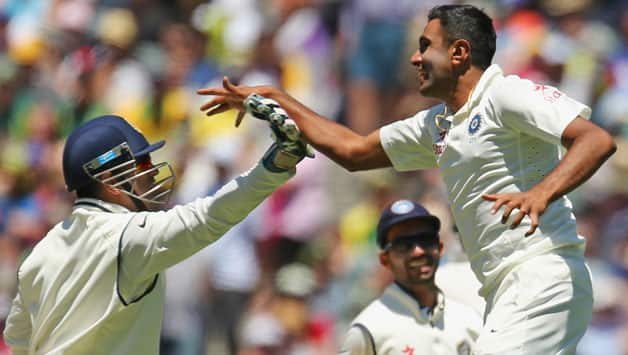 MS Dhoni (left) celebrates after the stumping of Mitchell Johnson, his 134th dismissal © Getty Images