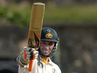 Hussey half-century pushes Australia to 273