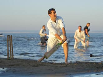 Cricket fanatics in England play match in sea
