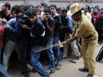 Police lathi-charge cricket fans in Bangalore