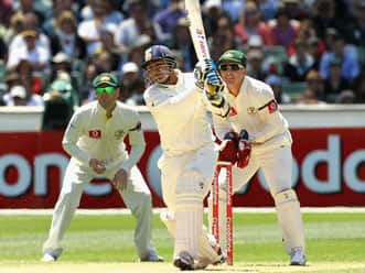Sehwag half-century leads solid India reply on second day