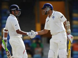 Laxman, Dravid half-centuries put India on top