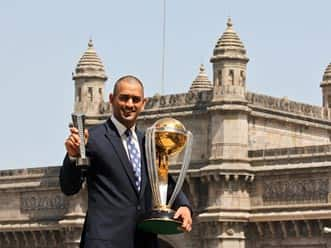Dhoni goes bald after World Cup triumph.