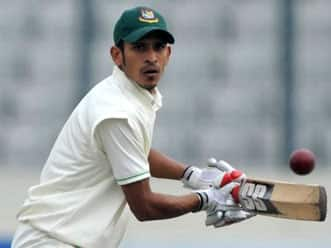 Nasir Hossain's unbeaten half-century keeps Pakistan at bay