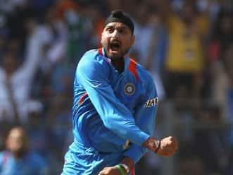 Harbhajan Singh celebrates recall to India side with three-wicket haul