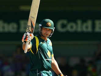 Peter Forrest's maiden century guides Australia to a challenging total at Hobart