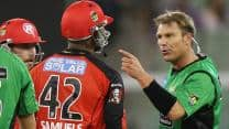 Shane Warne banned for one match, fined US$4,700 after spat with Marlon Samuels