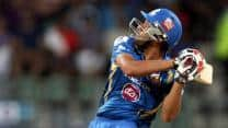 Rohit Sharma's 51 powers Mumbai Indians into semi-final with six-wicket win over Perth Scorchers
