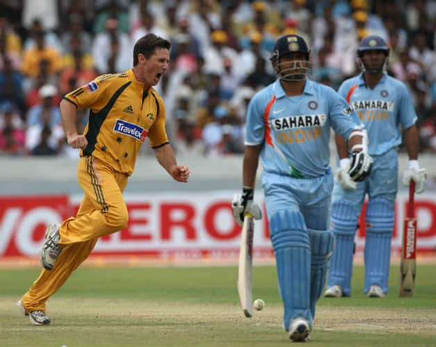 Brad Hogg (left) is ecstatic at getting the wicket of Sachin Tendulkar (centre) in the third One-Day International between India and Australia at the Rajiv Gandhi International Cricket Stadium on October 5, 2007 in Hyderabad. © Getty Images