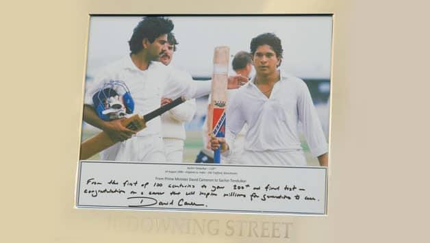 Sachin Tendulkar presented photograph of first Test ton by British Prime Minister David Cameron